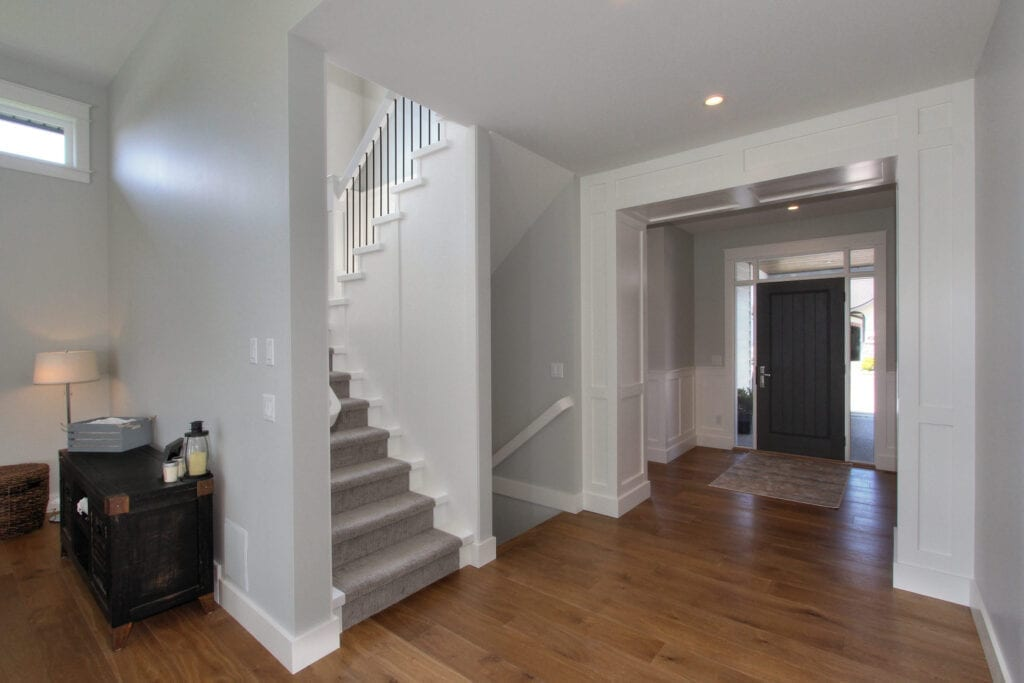 Entrance way with stairs and a dark grey door at 447 Lakepoint Drive