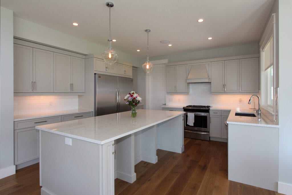 Custom kitchen at 447 Lakepoint Drive with light grey cabinets and a large island