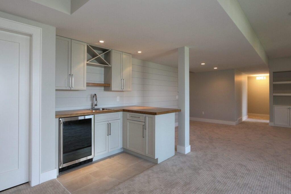 Custom wet bar in basement for 462 Rockview Lane home by Stark Homes