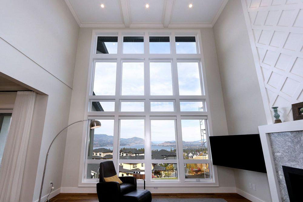 Large bay window overlooking Okanagan lake for a custom home livingroom