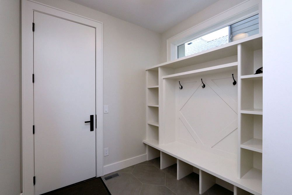 Mudroom custom interior and storage by Stark Homes