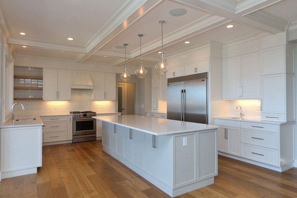 Bright white kitchen with hardwood floors at 462 Rockview Lane in Kelowna, custom home build by Tyler Stark