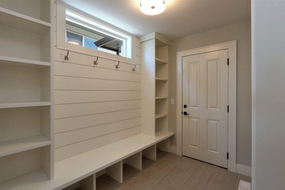 Mudroom door and custom shelving unit for 462 Rockview Lane in Kelowna, built by Stark Homes