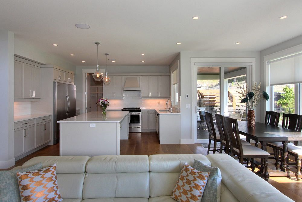 Stark Homes open concept home build with living room, dining room, and large bright kitchen