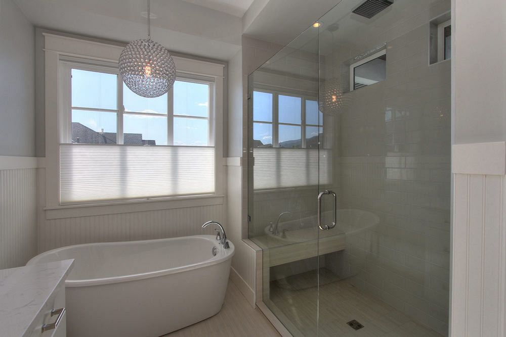 Stark Homes large custom walk-in shower with white tile and soaker tub