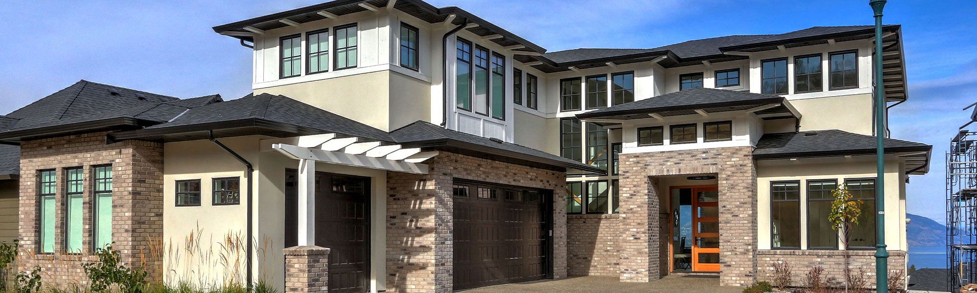 Front view of a three floor custom home build by Stark Homes