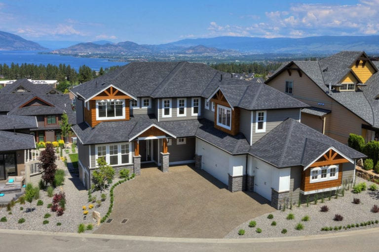 Aerial view of a custom home build by Stark Homes in Kelowna, with Okanagan Lake in the background